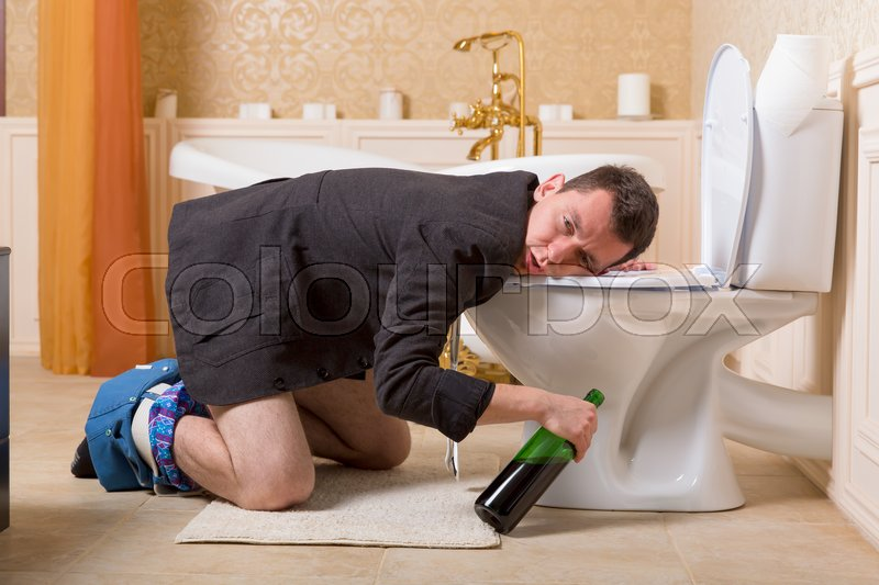 Funny Drunk Man With Bottle Of Wine Sick In The Toilet Bowl Luxury