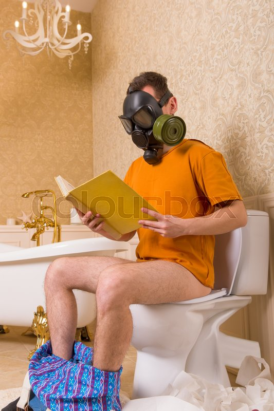 Man In Gas Mask With Pants Down Sitting On The Toilet And