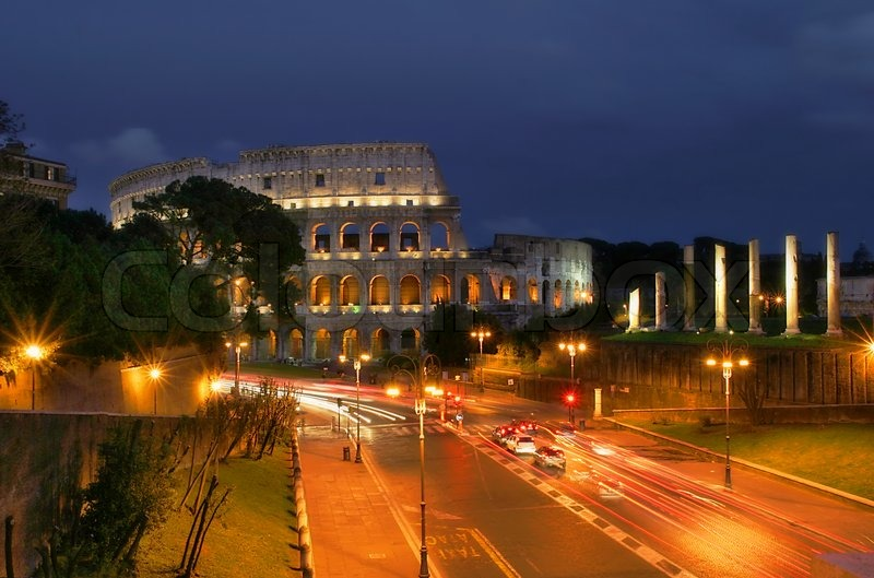 Famous Roman Coliseum And Illuminated Streets Of Rome At