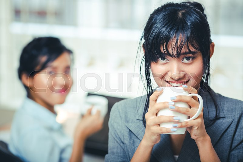 Businesswomen on the coffee break in office, stock photo