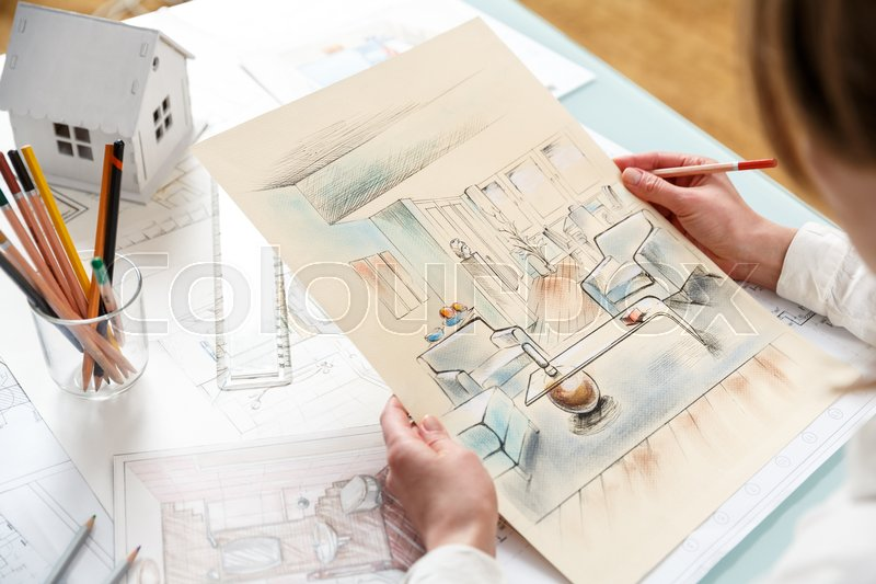 Interior Designer Working On Color Hand Drawings Of Interior At Work Place.  Photo Of Young Designers Work Concept | Stock Photo | Colourbox