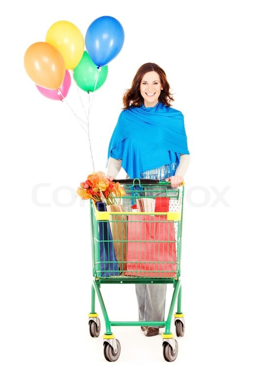 Stock image of 'Happy woman with shopping cart and balloons over white'