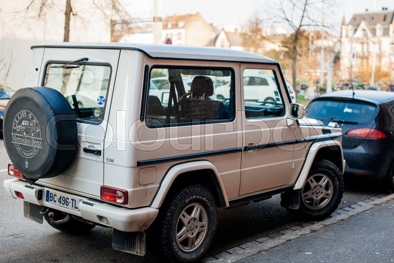 STRASBOURG, FRANCE   FEB 13, 2017: Rear View Of White Luxury White Mercedes  Benz G Class Suv Parced On French Street. The G Class Is A Mid Size  Four Wheel ...