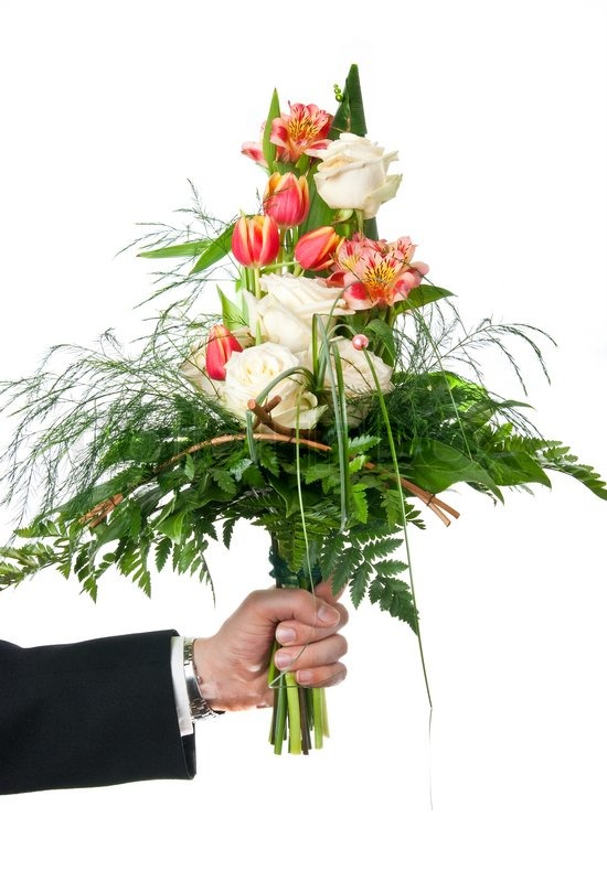 Fresh flowers bouquet in man\'s hand over white background | Stock ...