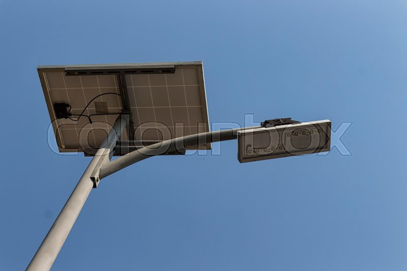 Solar pannel and LED street lamp pole on blue sky, stock photo