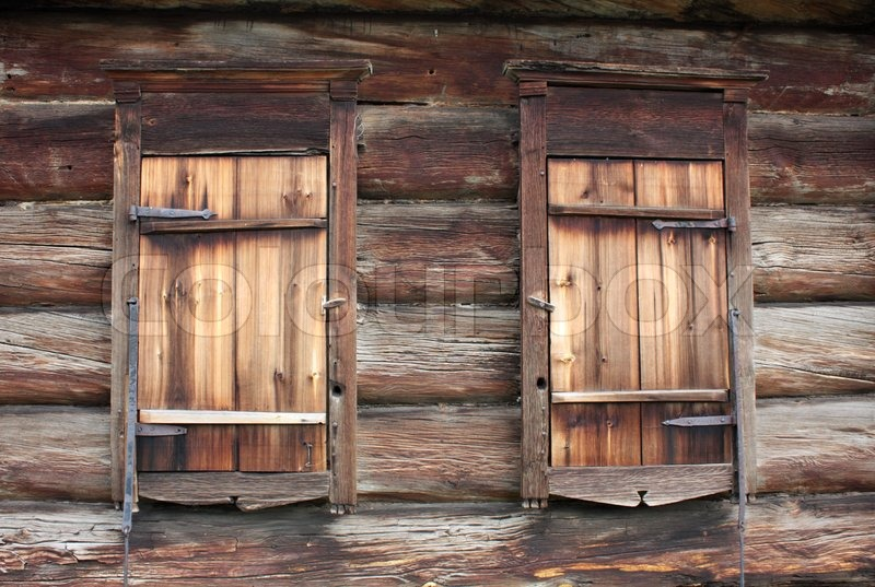 The Old Rustic Log Wall And Closed Windows Stock Photo