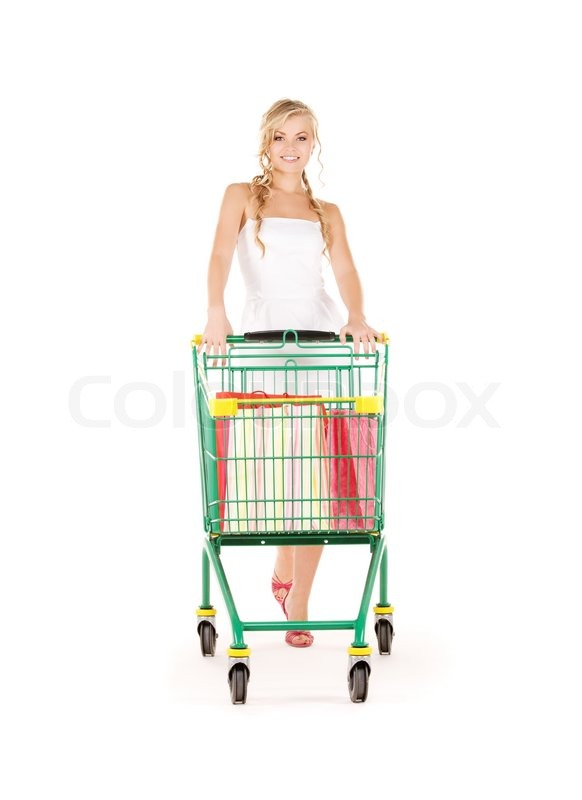 Stock image of 'Happy woman with shopping cart over white'