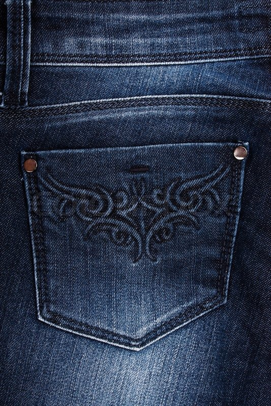 Back pocket on jeans with a yellow embroidery stock
