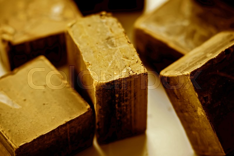 Chocolate. Black chocolate. A few cubes of black chocolate. Chocolate chunks. Chocolate bar pieces, stock photo