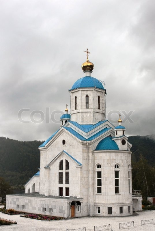 White Orthodox Temple With Gold Domes And A Dark Blue Roof