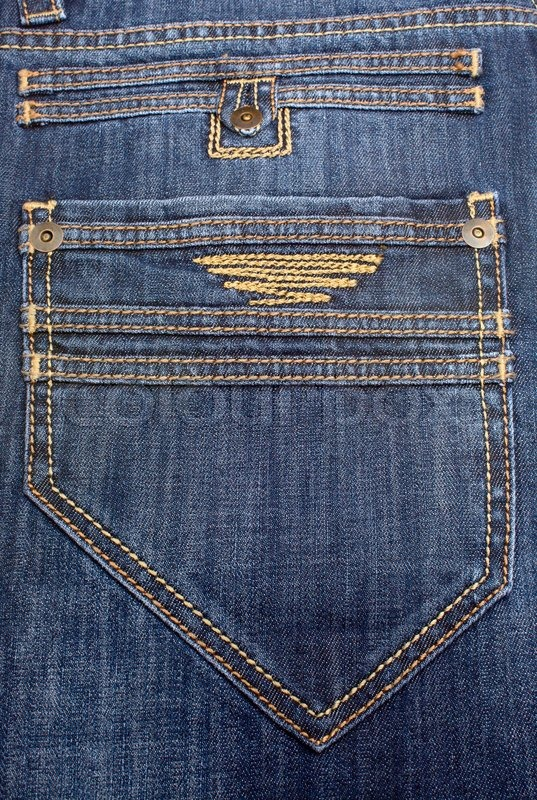 Big back pocket on jeans with a yellow embroidery stock