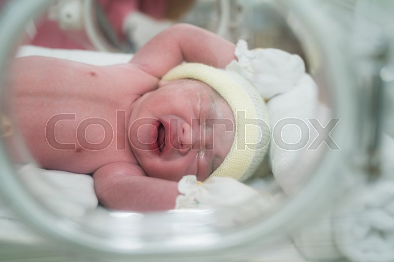 New born baby in hospiatal after delivery, Mon and babies concept, stock photo