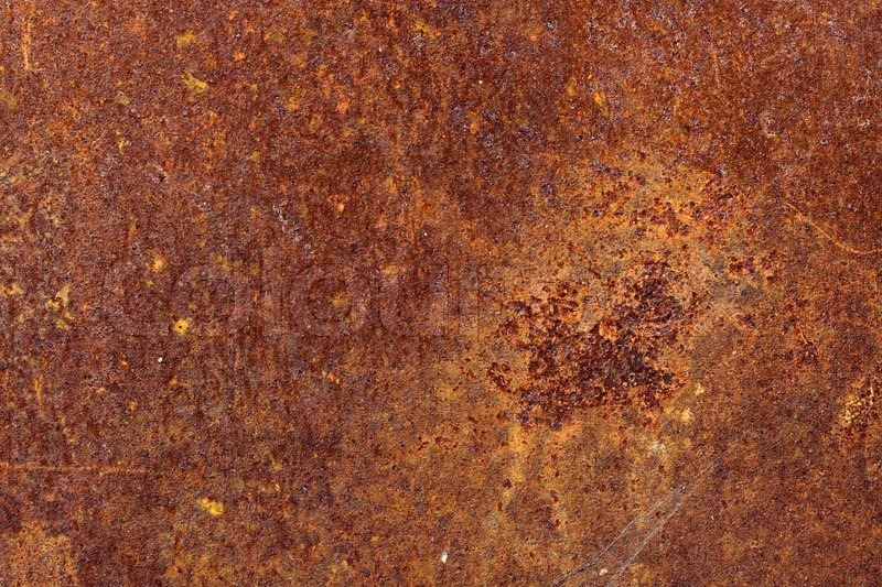 Background From The Rusty Scratched Sheet Of Metal Stock