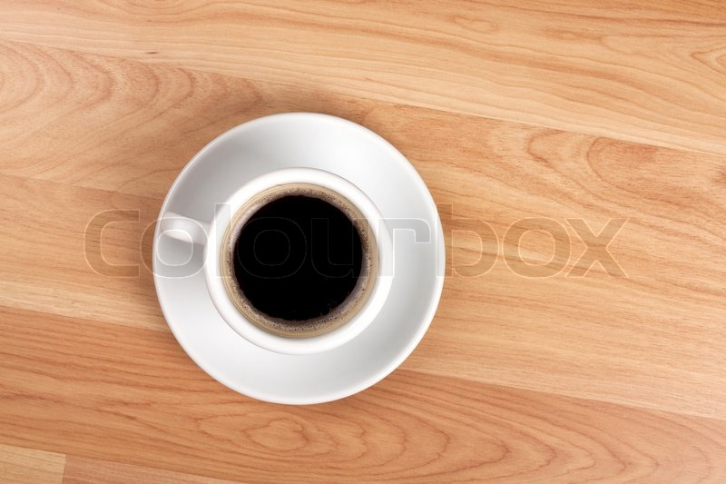 black coffee cup on wood table | stock photo | colourbox