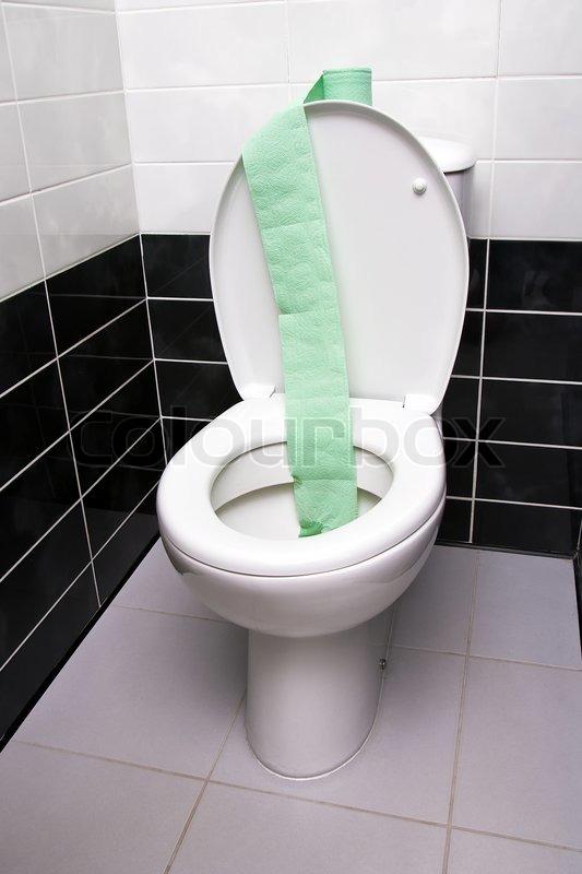 strip of green toilet paper inside open toilet bowl