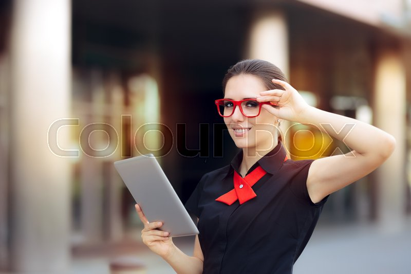 Smiling Businesswoman with Pc Tablet and Red Frame Glasses, stock photo