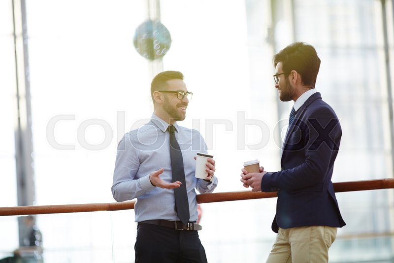 Conversation of successful bankers or co-workers at coffee-break, stock photo