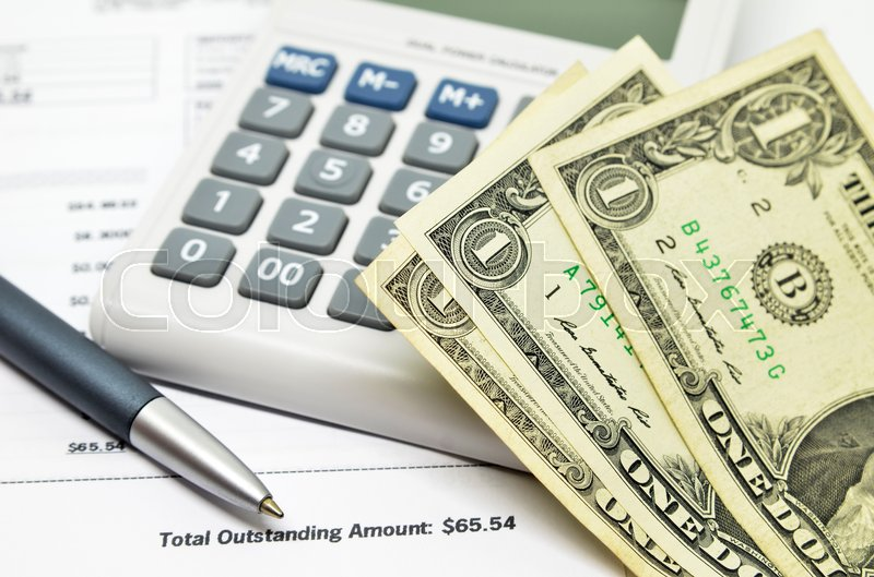 Financial composition on the table with money, calculator and pen, stock photo