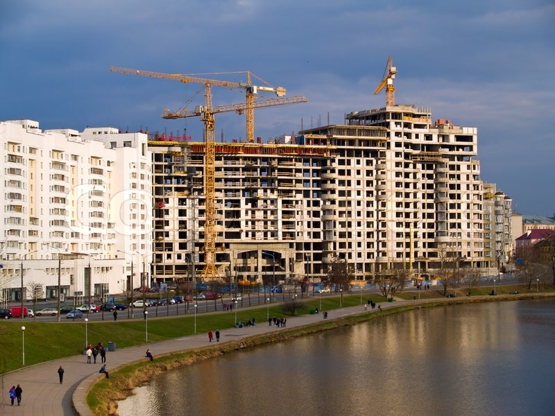 Apartment Building Under Construction Over Waters Under Blue Skies