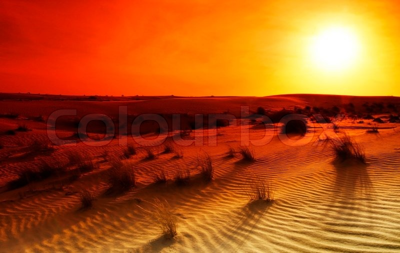Dramatic Sunset In The Desert Stock Photo Colourbox