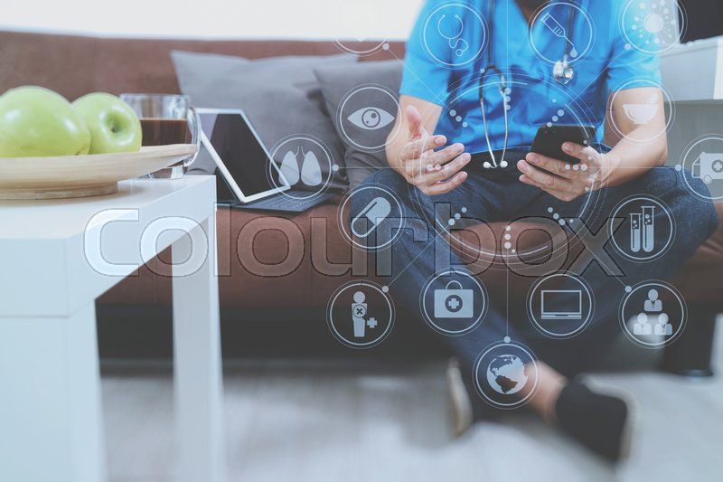 Medical and Health context,doctor hand working with smart phone,digital tablet computer,stethoscope,sitting on sofa in living room,virtual interface graphic icons diagram, stock photo