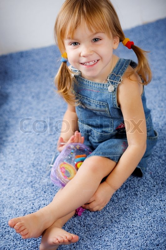 Funny Playful Little Girl On Blue Stock Photo Colourbox