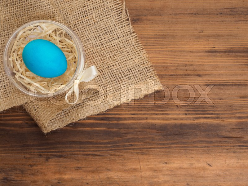 Easter colored egg on burlap and old wooden texture table mock up easter colored egg on burlap and old wooden texture table mock up for your greetings card poster or other design russian and ukrainian orthodox m4hsunfo