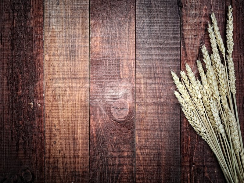 Golden wheat on the old wooden background | Stock Photo ...