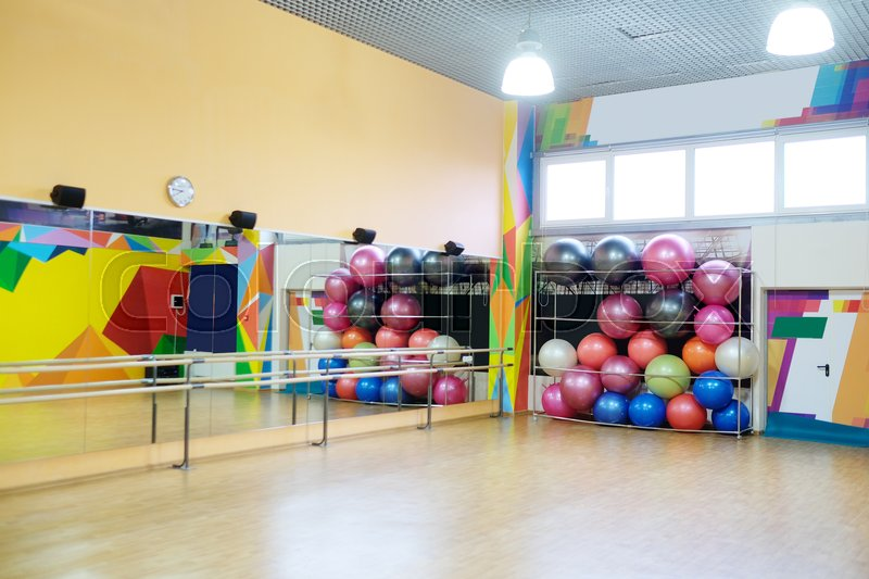 Fitness or dance hall with fitness equipment, stock photo