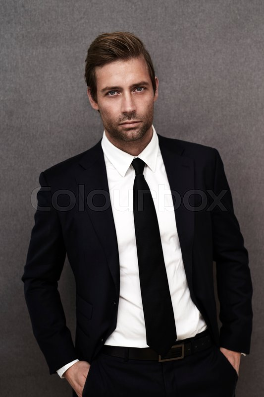 Smart guy in black suit, portrait | Stock Photo | Colourbox