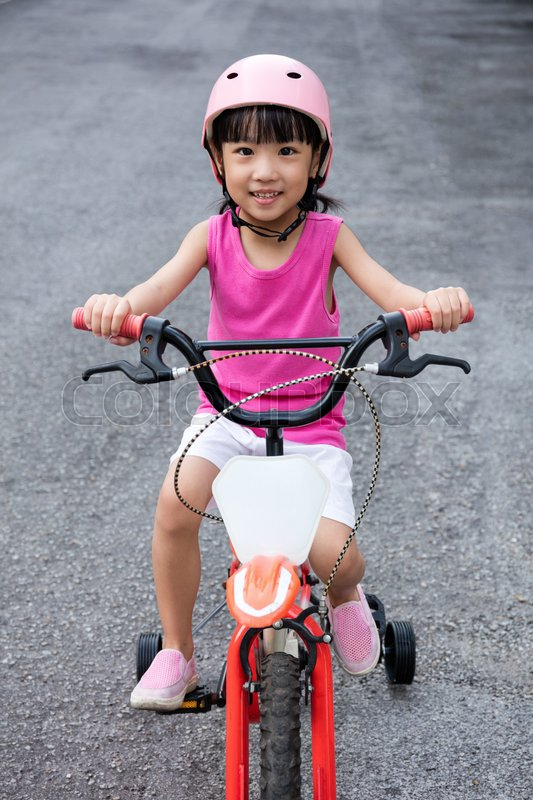 Asian Chinese Little Girl Riding Stock Photo Colourbox