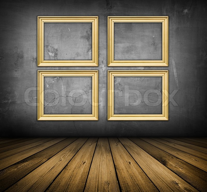 dark vintage interior with empty frames with copy space hanging on the wall stock photo