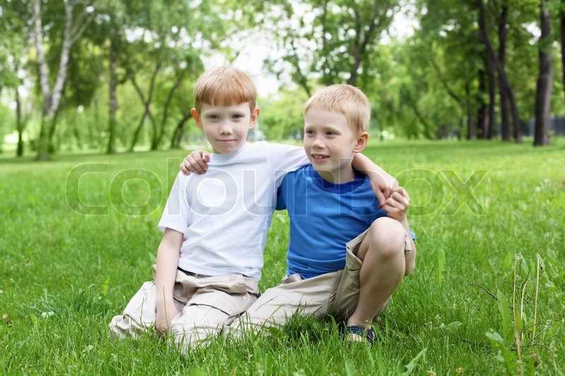 Stock image of 'Portrait of happy boys in the summer outdoors'