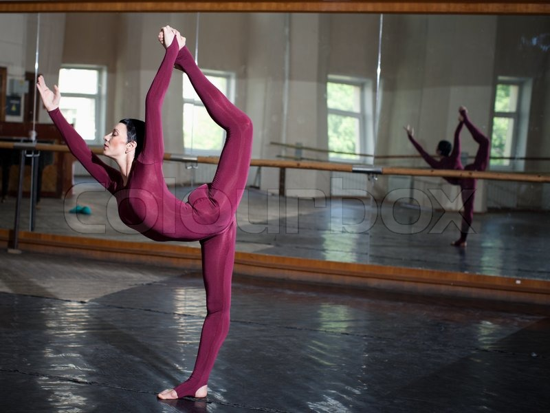Stock image of 'Jump training ballerina, rehearsal in a ballet class'