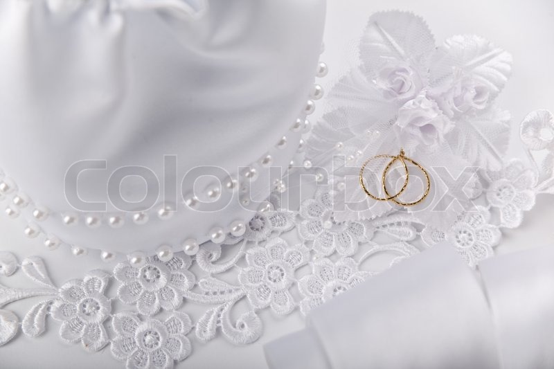 Wedding background with white silky decoration accessories and stock image of wedding background with white silky decoration accessories and artificial golden rings junglespirit Gallery