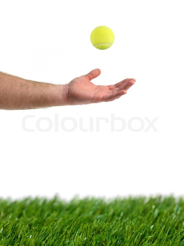 Stock image of 'Sporting tennis balls on artificial green grass'