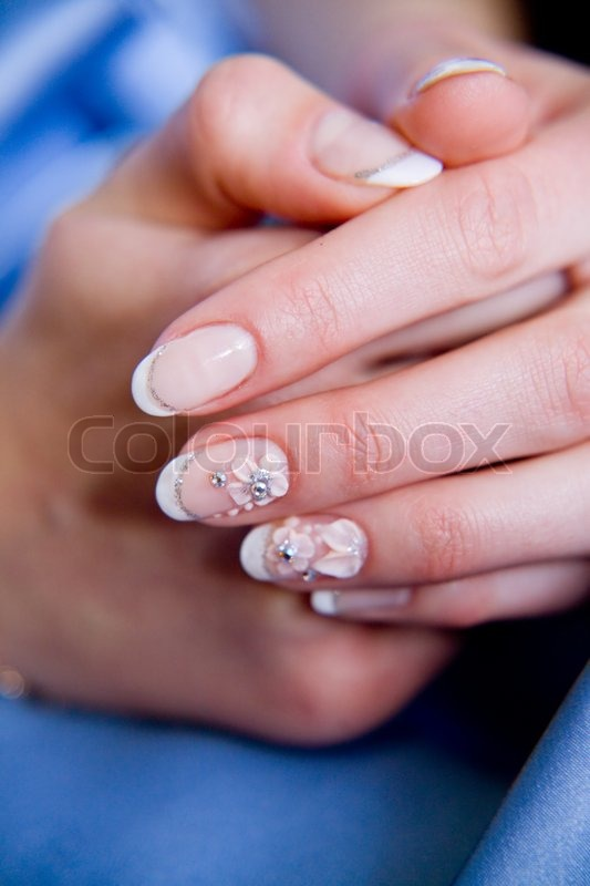 Beautiful woman fingers with french manicure and nail-art | Stock ...