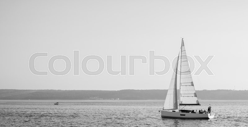 Sailing ship luxury yacht in Adriatic sea black and white, stock photo