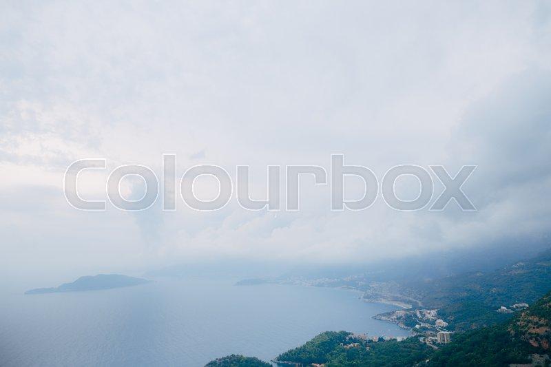 Budva Riviera in Montenegro at night. Sea coast and the mountains, stock photo