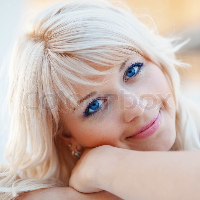 Closeup Face Of Beautiful Young Blond Girl With Blue Eyes
