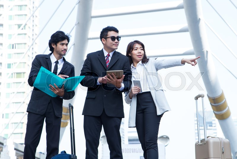 Group of business to talk about work and point work outside the office, stock photo