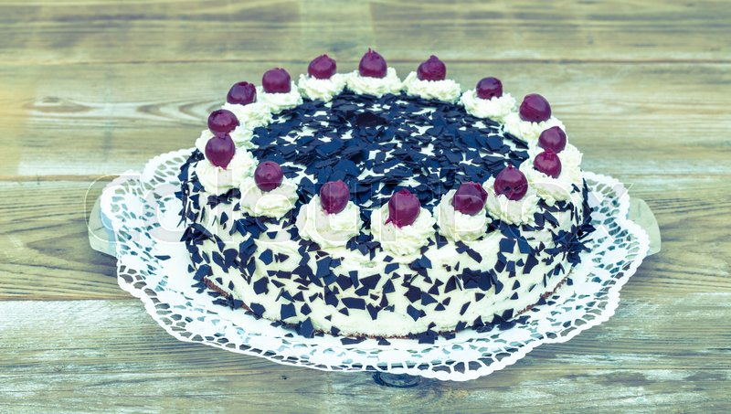 Black Forest cake on rustic wood, stock photo