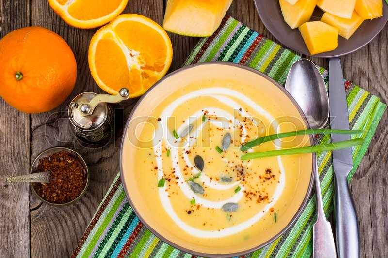 Fruit and vegetable dietary soup with orange. Studio Photo, stock photo