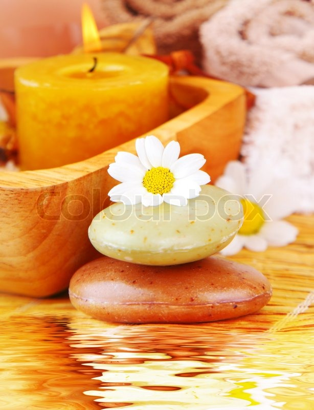 spa candle and organic herbal soap with daisy flower zen
