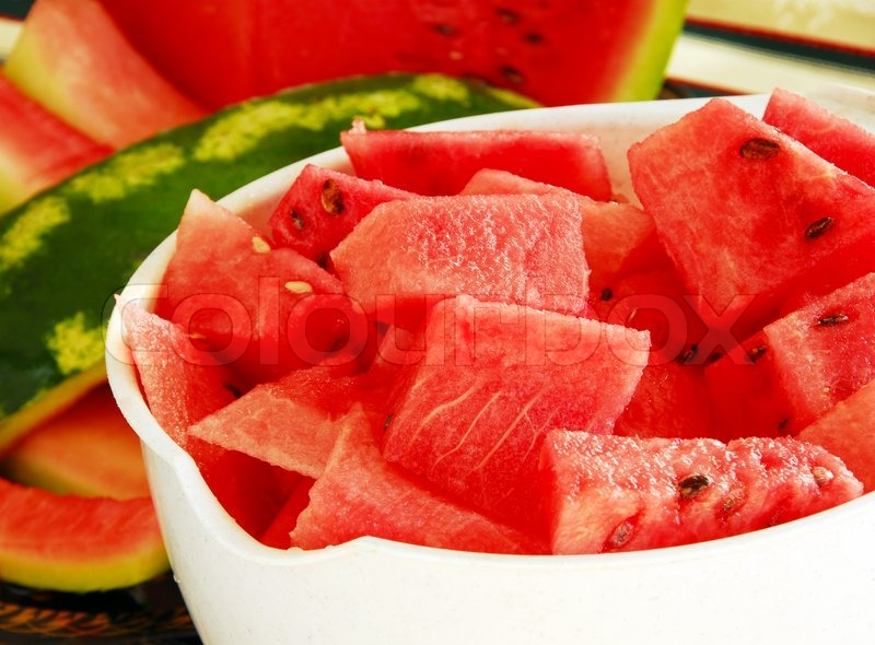 Fresh appetizing ripe red watermelon pieces in white bowl | Stock ...