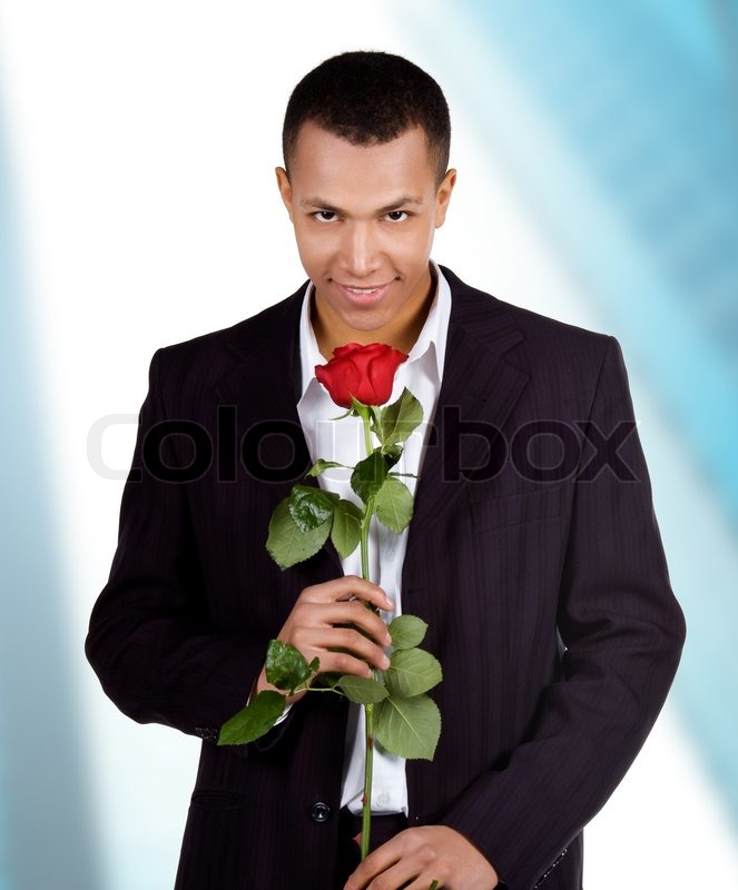 Young men with the red rose on blue background stock for Offrir rose