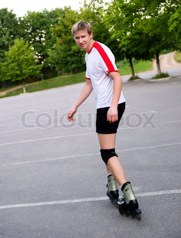 young active roller blade skater on the park stock photo