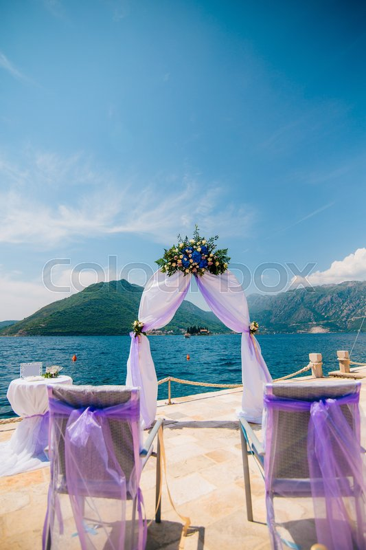 Arch for the wedding ceremony on the sea, stock photo