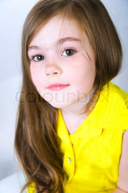 portrait of a pretty little girl over white stock photo. Black Bedroom Furniture Sets. Home Design Ideas