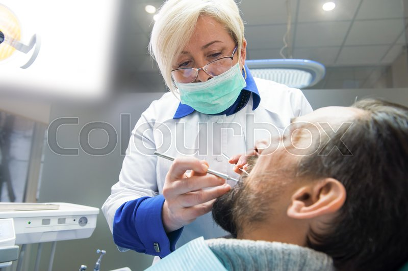 Stock Image Of Work Female Dentist Doctor And Patient